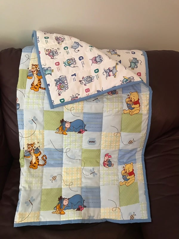 "This quilt is machine stitched and is the perfect gift for a child. Dimensions are 37"" x 42"" Starting bid is $50. Bid and view at Pinecroft, 8122 Rogers Rd, Aylmer, ON N5H 2R4"