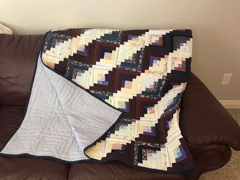 This quilt is hand stitched, log cabin style and is perfect to stay warm for the upcoming cold winter nights Dimensions are 82 x 82 Starting bid is $400. Bid and view at62 Talbot St E, Aylmer, ON N5H 1H4.